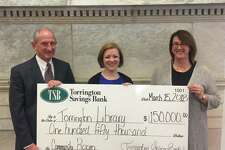 Torrington Savings Bank has made a $150,000 donation to the Torrington Library, for the recently named Torrington Savings Bank Community Room. This new gathering space was created during the latest renovation of the library which was completed in 2016, and aligns with the bank's commitment to community and provides a valuable benefit to all, according to a release. The Torrington Library encourages public use of meeting rooms as gathering places to exchange ideas, access and share information and participate in programs created for public enjoyment, public education and civic engagement. From left are John E. Janco, president and CEO of Torrington Savings Bank, Jessica Gueniat, director of the Torrington Library, and Lesa A. Vanotti, senior vice president and CFO of Torrington Savings Bank and a Corporator of the Torrington Library.