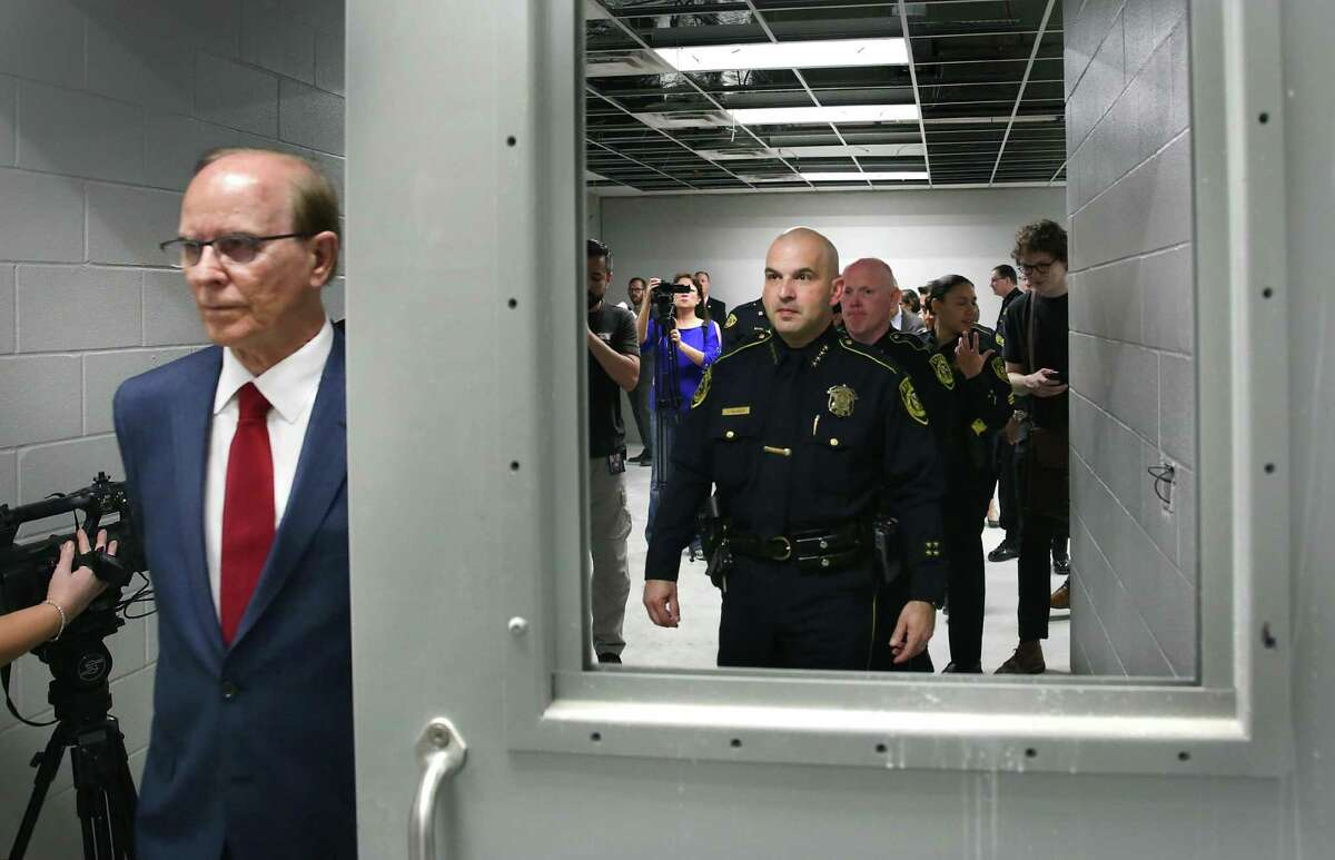 Bexar County Judge Nelson Wolff and Sheriff Javier Salazar join other county officials in a 2018 tour of the new Justice Intake and Assessment Center next to the Bexar County Jail. Wolff and other county officials said they'll work with the sheriff in 2021 to reduce jail overtime that the local deputies' union has said is putting an unbearable strain on detention officers.