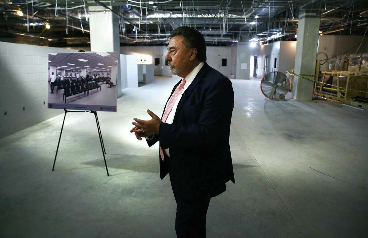 Bexar County Judicial Services Director Mike Lozito shows off the Justice Intake and Assessment Annex in 2018. The property room at the addition is way too small.