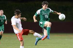 Defender Agustin Banos (20) of North Shore and Midfielder Nico Mattioli (15) of Strake Jesuit compete for a loose ball during the first half of a 6A-III regional semifinal soccer playoff between the Strake Jesuit Crusaders and the North Shore Mustangs on Friday, April 13, 2018 at Abshier Stadium, Deer Park, TX.