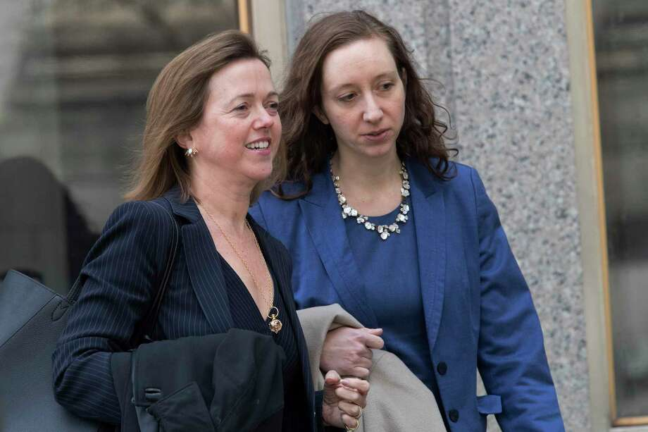 Attorney Joanna Hendon, left, representing President Trump, leaves federal court, Friday, April 13, 2018, in New York. Lawyers for President Donald Trump and his personal attorney, Michael Cohen, told a federal judge in New York on Friday that they believe some of the documents and devices seized from Cohen during an FBI raid are protected by attorney-client privilege, and they want a chance to review the items before prosecutors get to examine them. (AP Photo/Mary Altaffer) Photo: Mary Altaffer / Copyright 2018 The Associated Press. All rights reserved.