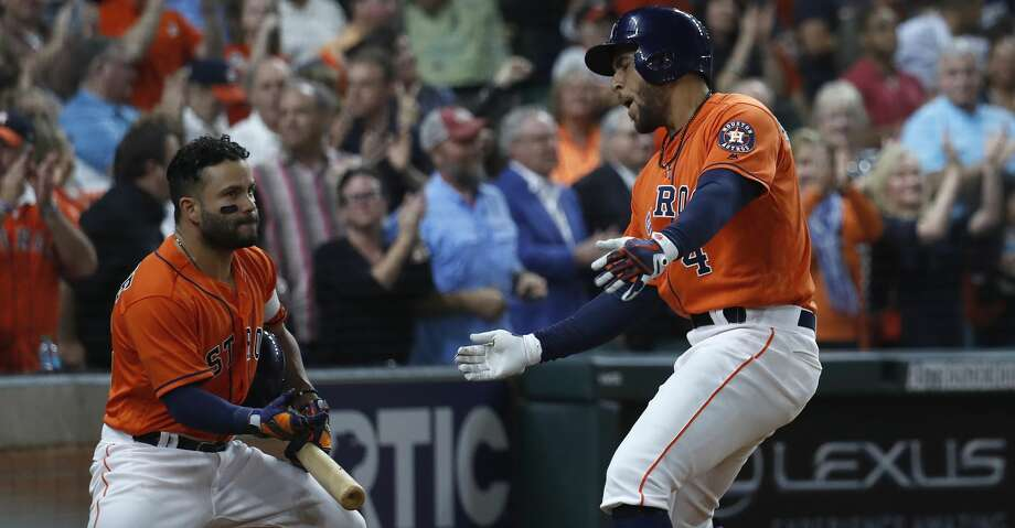Houston Astros George Springer (4) celebrates with Jose Altuve after his  second home run of the night during the fifth inning of an MLB game at Minute Maid Park, Friday, April 13, 2018, in Houston.   ( Karen Warren / Houston Chronicle ) Photo: Karen Warren/Houston Chronicle