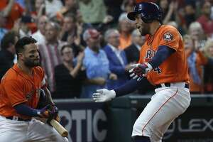 Houston Astros George Springer (4) celebrates with Jose Altuve after his  second home run of the night during the fifth inning of an MLB game at Minute Maid Park, Friday, April 13, 2018, in Houston.   ( Karen Warren / Houston Chronicle )