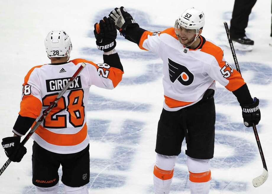Philadelphia Flyers' Shayne Gostisbehere (53) celebrates his goal with Claude Giroux (28) during the first period in Game 2 of an NHL first-round hockey playoff series against the Pittsburgh Penguins in Pittsburgh, Friday, April 13, 2018. (AP Photo/Gene J. Puskar) Photo: Gene J. Puskar / Copyright 2018 The Associated Press. All rights reserved.