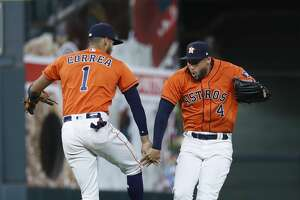 Houston Astros shortstop Carlos Correa (1) and Houston Astros center fielder George Springer (4) celebrate the Astros 3-2 win over the Texas Rangers after an MLB game at Minute Maid Park, Friday, April 13, 2018, in Houston.   ( Karen Warren / Houston Chronicle )