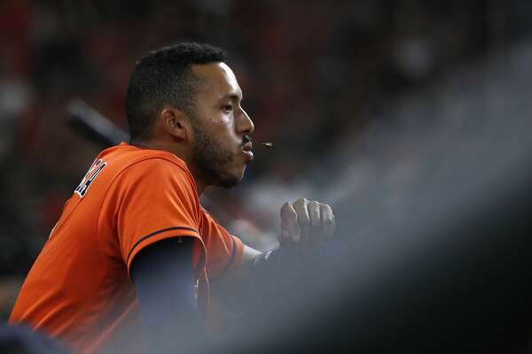 Houston Astros shortstop Carlos Correa (1) sits in the dugout spitting seeds during the fourth inning of an MLB game at Minute Maid Park, Friday, April 13, 2018, in Houston. ( Karen Warren / Houston Chronicle )