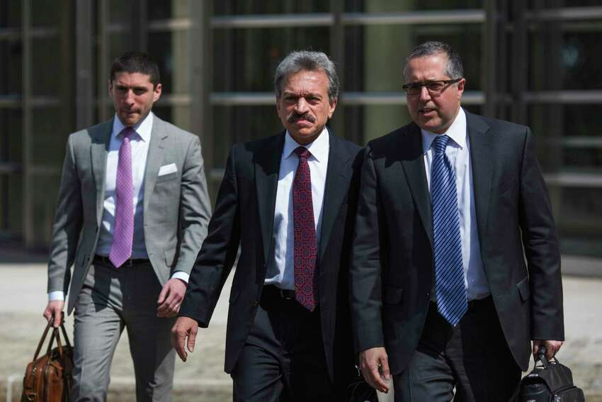 Attorneys representing NXIVM leader Keith Raniere, Mark Agnifilo, right, and Paul DerOhannesian, II, center, leave following Raniere's arraignment in federal court on Friday, April 13, 2018, in New York (AP Photo/Kevin Hagen)