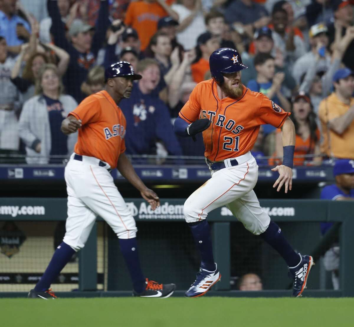 Houston Astros left fielder Derek Fisher (21) rounds third on his way home to score the winning run on a double by Max Stassi of an MLB game at Minute Maid Park, Friday, April 13, 2018, in Houston. ( Karen Warren / Houston Chronicle )