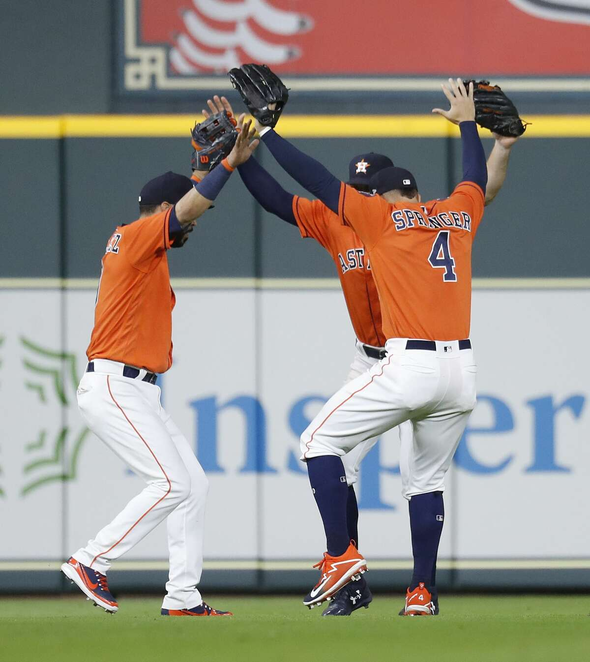 Houston Astros outfielders celebrate the Astros 3-2 win over the Texas Rangers after an MLB game at Minute Maid Park, Friday, April 13, 2018, in Houston. ( Karen Warren / Houston Chronicle )