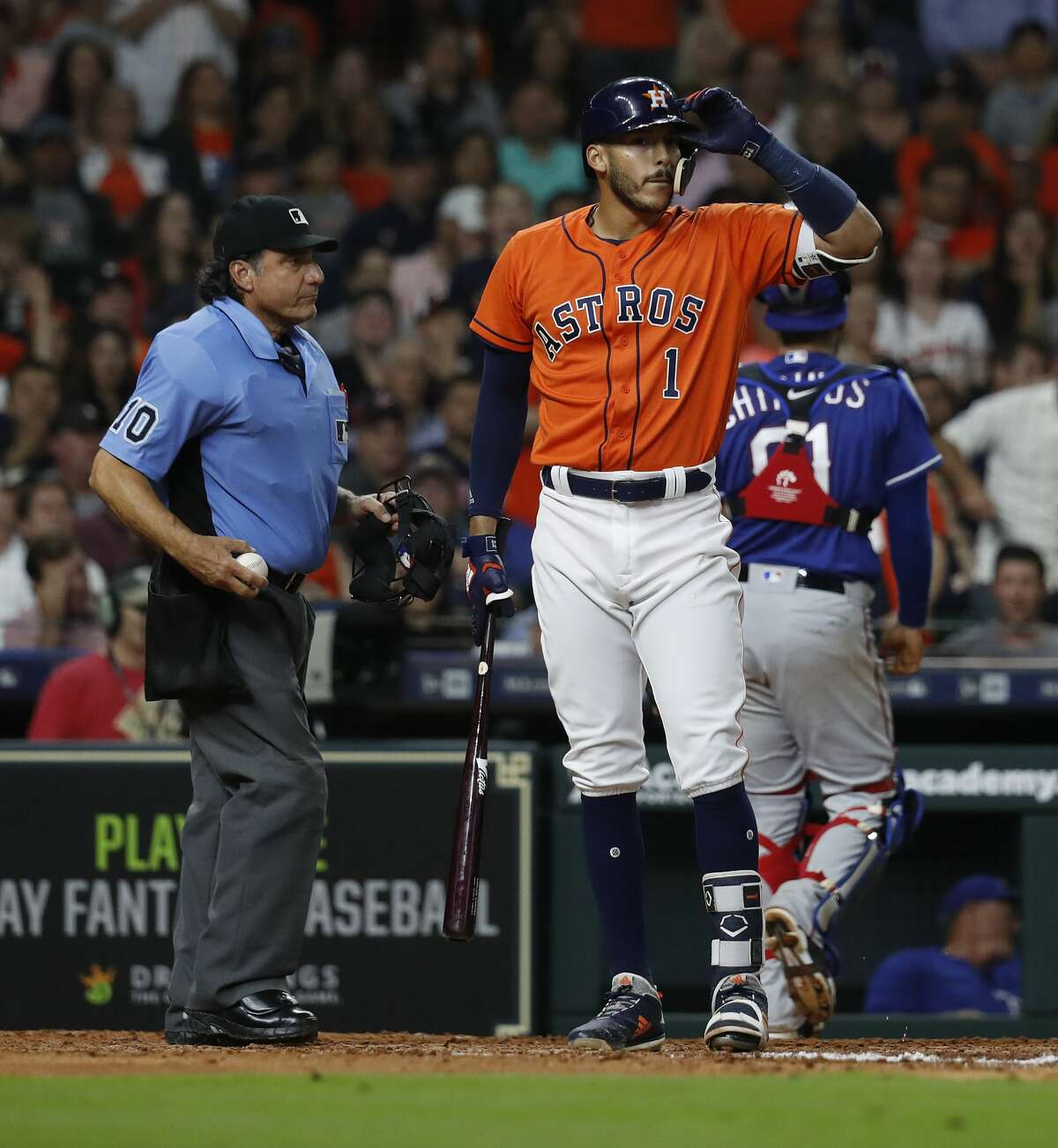 Houston Astros Carlos Correa (1) reacts after striking out during the seventh inning of an MLB game at Minute Maid Park, Friday, April 13, 2018, in Houston. ( Karen Warren / Houston Chronicle )