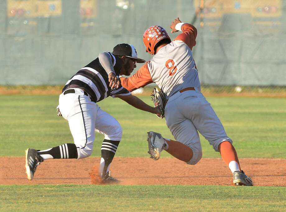 Dee Andre Torres is tagged out by United South's shortstop Bernardo Pedraza. Torres had five hits Friday leading Eagle Pass to a 10-2 victory at Krueger Field. Photo: Cuate Santos /Laredo Morning Times / Laredo Morning Times