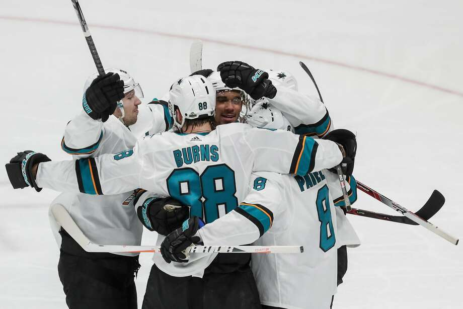 San Jose Sharks teammates congratulate forward Evander Kane after he scored a second-period goal against the Anaheim Ducks during Game 1 in the first round of the Stanley Cup Playoffs at Honda Center in Anaheim, Calif., on Thursday, April 12, 2018. (Robert Gauthier/Los Angeles Times/TNS) Photo: Robert Gauthier / TNS