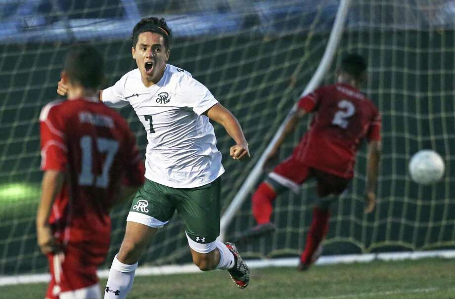 The Rattlers' Alex Salgado celebrates after blowing a shot into the goal past Huskie defenders in the first half as Reagan plays Juarez-Lincoln in Region IV-6A soccer playoffs at Blossom Soccer Stadium on April 13, 2018. Photo: Tom Reel, Staff / San Antonio Express-News / 2017 SAN ANTONIO EXPRESS-NEWS