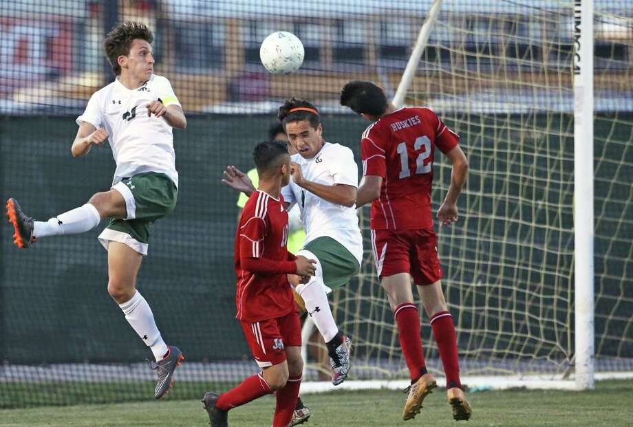 Rattler players Michael Morell (left) and Alex Salgado attempt to score on a side kick as Reagan plays Juarez-Lincoln in Region IV-6A soccer playoffs at Blossom Soccer Stadium on April 13, 2018. Photo: Tom Reel, Staff / San Antonio Express-News / 2017 SAN ANTONIO EXPRESS-NEWS