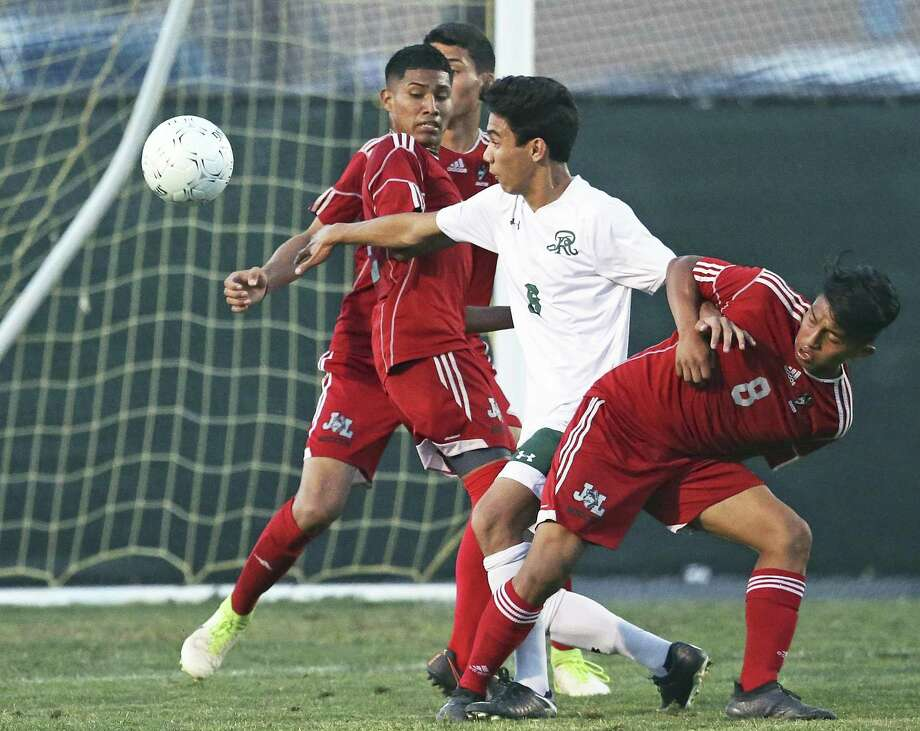 Reagan's Jared Olsen gets through defenders to take a shot on goal as Reagan plays Juarez-Lincoln in Region IV-6A soccer playoffs at Blossom Soccer Stadium on April 13, 2018. Photo: Tom Reel, Staff / San Antonio Express-News / 2017 SAN ANTONIO EXPRESS-NEWS