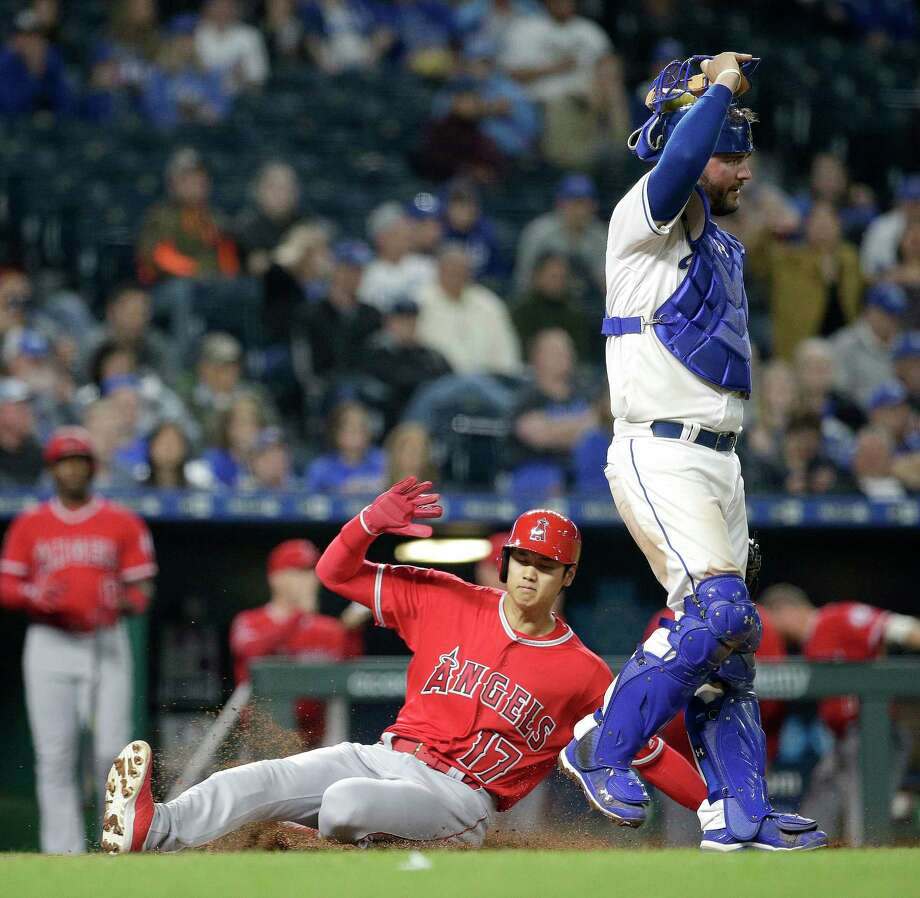 Los Angeles Angels' Shohei Ohtani (17) slides home past Kansas City Royals' Cam Gallagher to score on a sacrifice fly hit by Ian Kinsler during the eighth inning of a baseball game Friday, April 13, 2018, in Kansas City, Mo. (AP Photo/Charlie Riedel) Photo: Charlie Riedel / Copyright 2018 The Associated Press. All rights reserved.