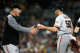 SAN DIEGO, CA - APRIL 13:  Manager Bruce Bochy takes Ty Blach #50 of the San Francisco Giants out of the game during the sixth inning of a game against the San Diego Padres  at PETCO Park on April 13, 2018 in San Diego, California.  (Photo by Sean M. Haffey/Getty Images)