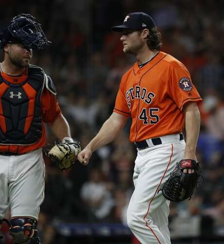 Houston Astros starting pitcher Gerrit Cole (45) reacts with catcher Brian McCann (16) after striking out Texas Rangers Isiah Kiner-Falefa during the fifth inning of an MLB game at Minute Maid Park, Friday, April 13, 2018, in Houston.   ( Karen Warren / Houston Chronicle ) Photo: Karen Warren/Houston Chronicle