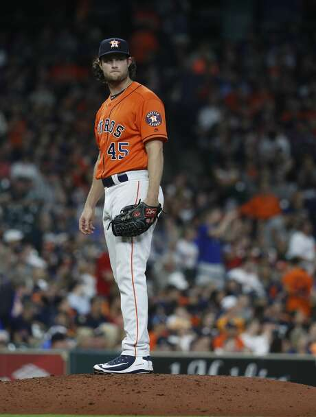 Houston Astros starting pitcher Gerrit Cole (45) reacts as Texas Rangers Robinson Chirinos rounds the bases on a home run during the seventh inning of an MLB game at Minute Maid Park, Friday, April 13, 2018, in Houston.   ( Karen Warren / Houston Chronicle ) Photo: Karen Warren/Houston Chronicle