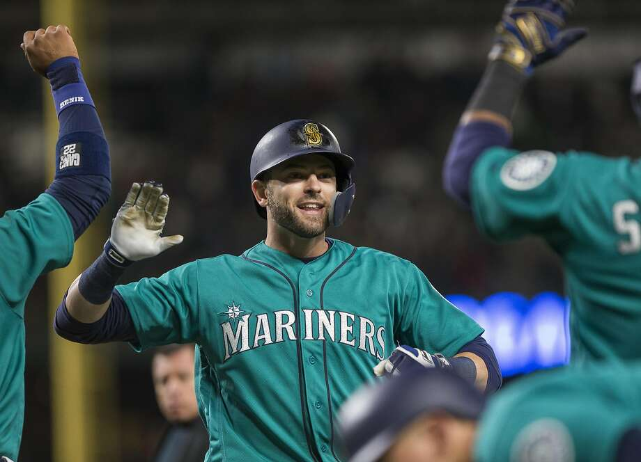 SEATTLE, WA - APRIL 13:  Mitch Haniger #17 of the Seattle Mariners is greeted by Robinson Cano #22, left and Kyle Seager #15, right, after hitting a three run home run to put the Mariners ahead against the Oakland Athletics in the seventh inning at Safeco Field on April 13, 2018 in Seattle, Washington. (Photo by Lindsey Wasson/Getty Images) Photo: Lindsey Wasson / Getty Images