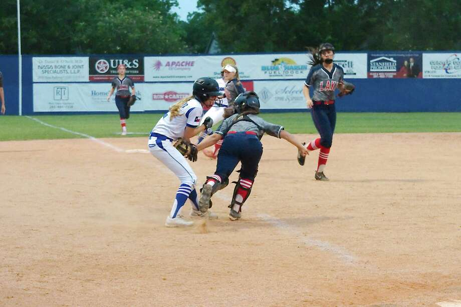 Clear Lake's Adelaide Lewis (1) runs down Friendswood's Cierra Langston (2) and makes the tag for an out Friday at Friendswood High School. Photo: Kirk Sides / © 2018 Kirk Sides / Houston Chronicle