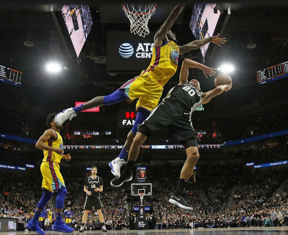 San Antonio Spurs guard Manu Ginobili (20) tries to shoot over Golden State Warriors center Jordan Bell (2) during the first half of an NBA game, Monday, March 19, 2018, in San Antonio. San Antonio won 89-75. (AP Photo/Ronald Cortes) Photo: Ronald Cortes / Associated Press