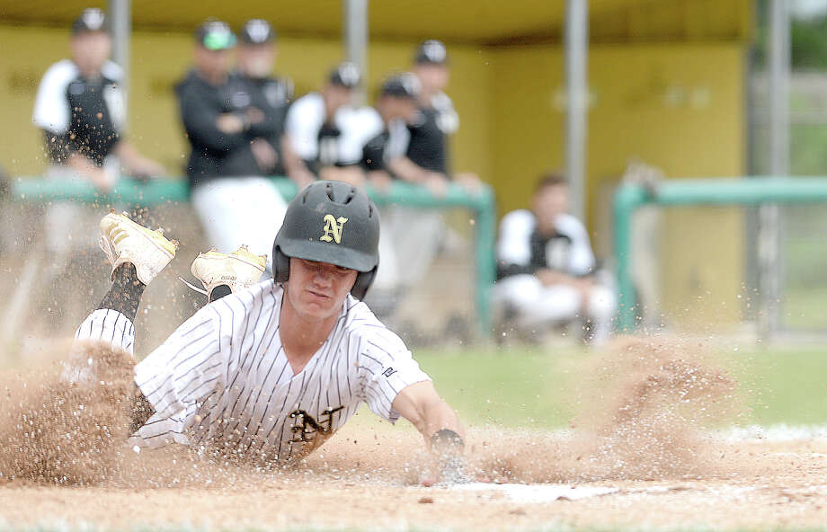 Nederland's Landon Hiltz dives into home plate ahead of the throw to Vidor's catcher during their District 22-5A game at Nederland. Vidor won Tuesday's match-up and ended Nederland's district winning streak.  Photo taken Friday, April 13, 2018 Kim Brent/The Enterprise Photo: Kim Brent / BEN