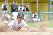 Nederland's Landon Hiltz dives into home plate ahead of the throw to Vidor's catcher during their District 22-5A game at Nederland. Vidor won Tuesday's match-up and ended Nederland's district winning streak.  Photo taken Friday, April 13, 2018 Kim Brent/The Enterprise