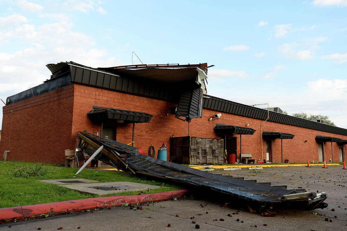 High winds and a possible tornado destroyed the roof of the Lamar University Police Station. LUPD Cpl. Jarrod Samford said one dispatcher was in the building during the storm and was uninjured after riding it out under her desk. Photo taken Saturday 4/14/18 Ryan Pelham/The Enterprise