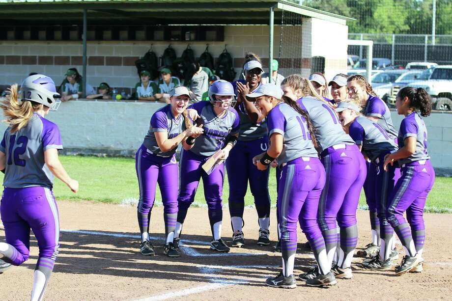 The Lady Broncos wait to greet Haily Pence at home plate after she hit a solo home run to put Dayton up 1-0 in the first inning. Photo: David Taylor / David Taylor