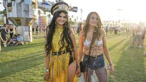 Kate Graham, left, and Sam Todd attend the Coachella Music & Arts Festival at the Empire Polo Club on Friday, April 13, 2018, in Indio, Calif. (Photo by Amy Harris/Invision/AP)
