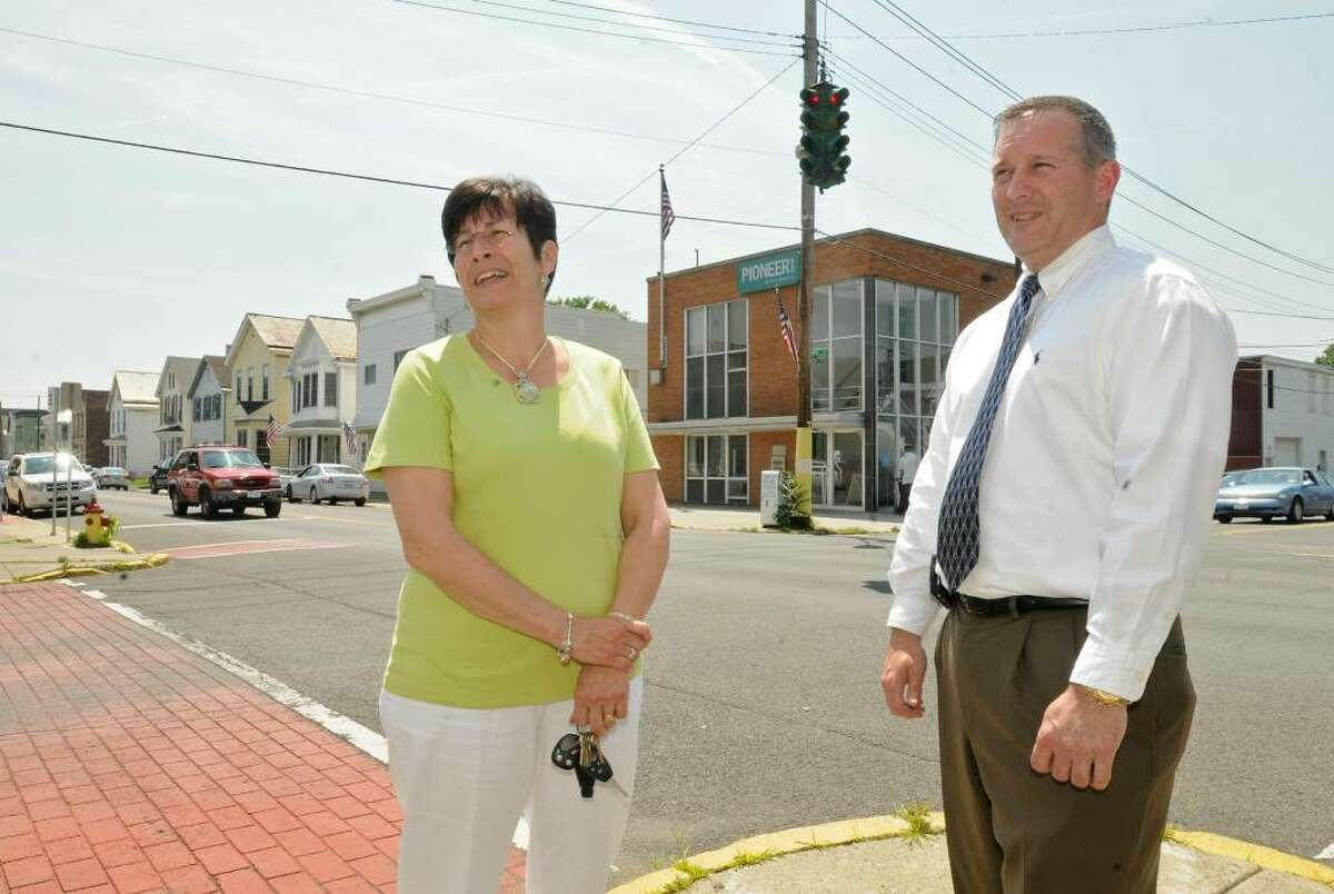 Green Island Mayor Ellen McNulty-Ryan and executive assistant Sean Ward stand under traffic light with duct tape on the intersection of Arch and George Streets in the village. (Lori Van Buren / Times Union)