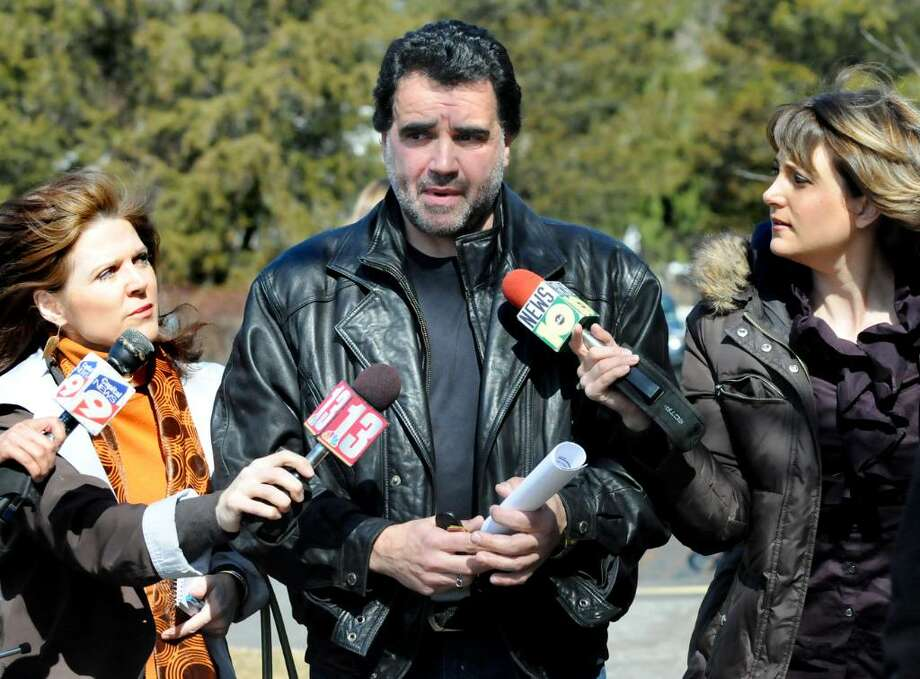Ernie Paragallo, center, leaves the courthouse surrounded by the media following his verdict  on Wednesday, March 10, 2010, at Greene County Court in Catskill, N.Y. Paragallo is found guilty on 33 of 34 counts of animal cruelty. (Cindy Schultz / Times Union) Photo: CINDY SCHULTZ / 00007805A