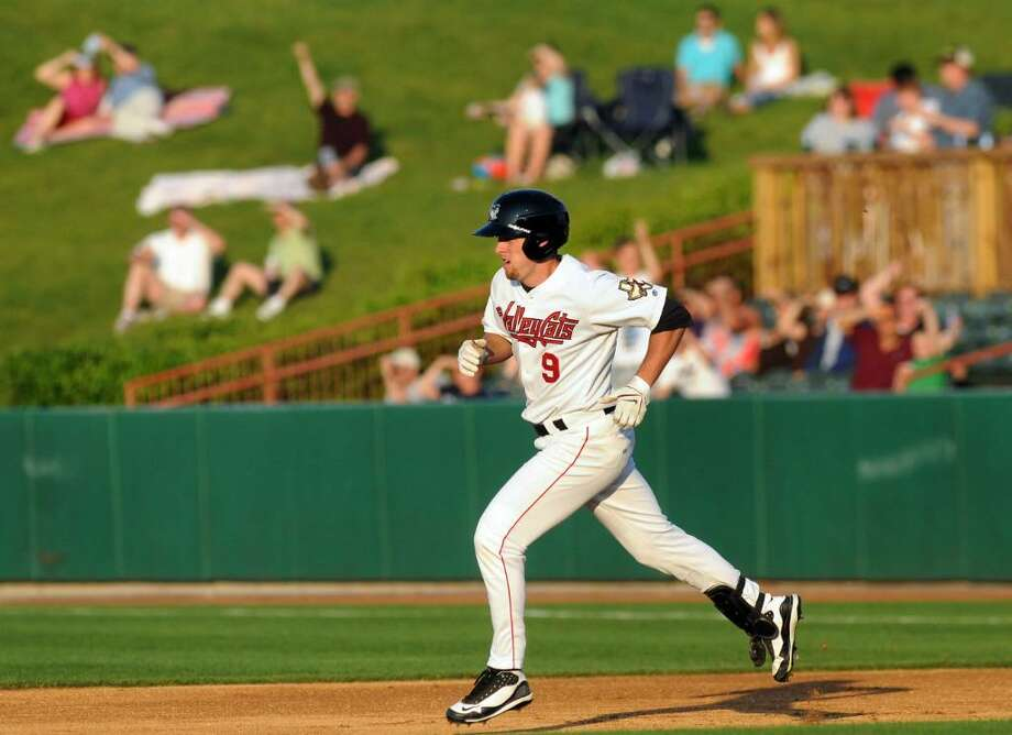 Valley Cats Michael Kvasnicka (9) runs the bases as the outfield crowd cheers for his home run hit during thei home opening baseball game against Connecticut on Friday, June 18, 2010, at Joe Bruno Stadium in Troy, N.Y. (Cindy Schultz / Times Union) Photo: CINDY SCHULTZ