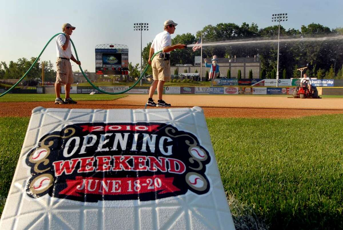 Grounds crew hose down the infield as they prepare the field for the Valley Cats home opening baseball game against Connecticut on Friday, June 18, 2010, at Joe Bruno Stadium in Troy, N.Y. (Cindy Schultz / Times Union)