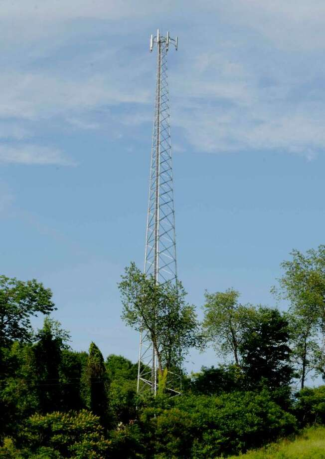 A cell tower on the land next to Sharon Zayachek in Argyle, New York 6/15/2010.( Michael P. Farrell / Times Union ) Photo: MICHAEL P. FARRELL