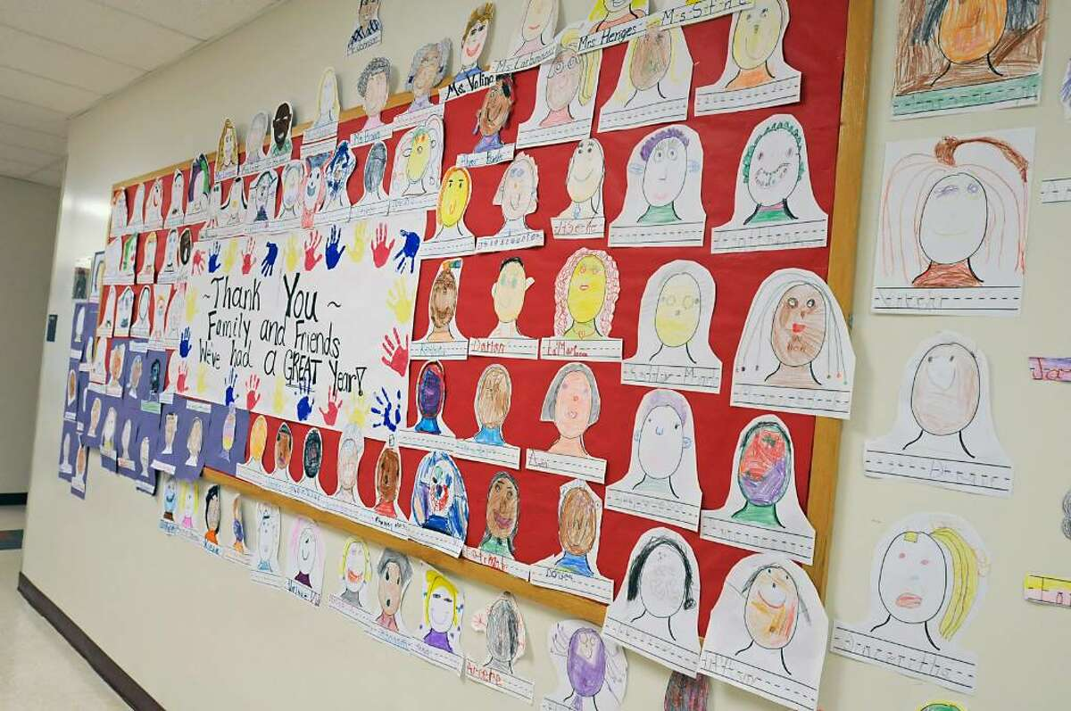 Student artwork hangs in the hallway in the New Covenant Charter School in Albany, which will close this week at the end of the school year. (Lori Van Buren/Times Union)