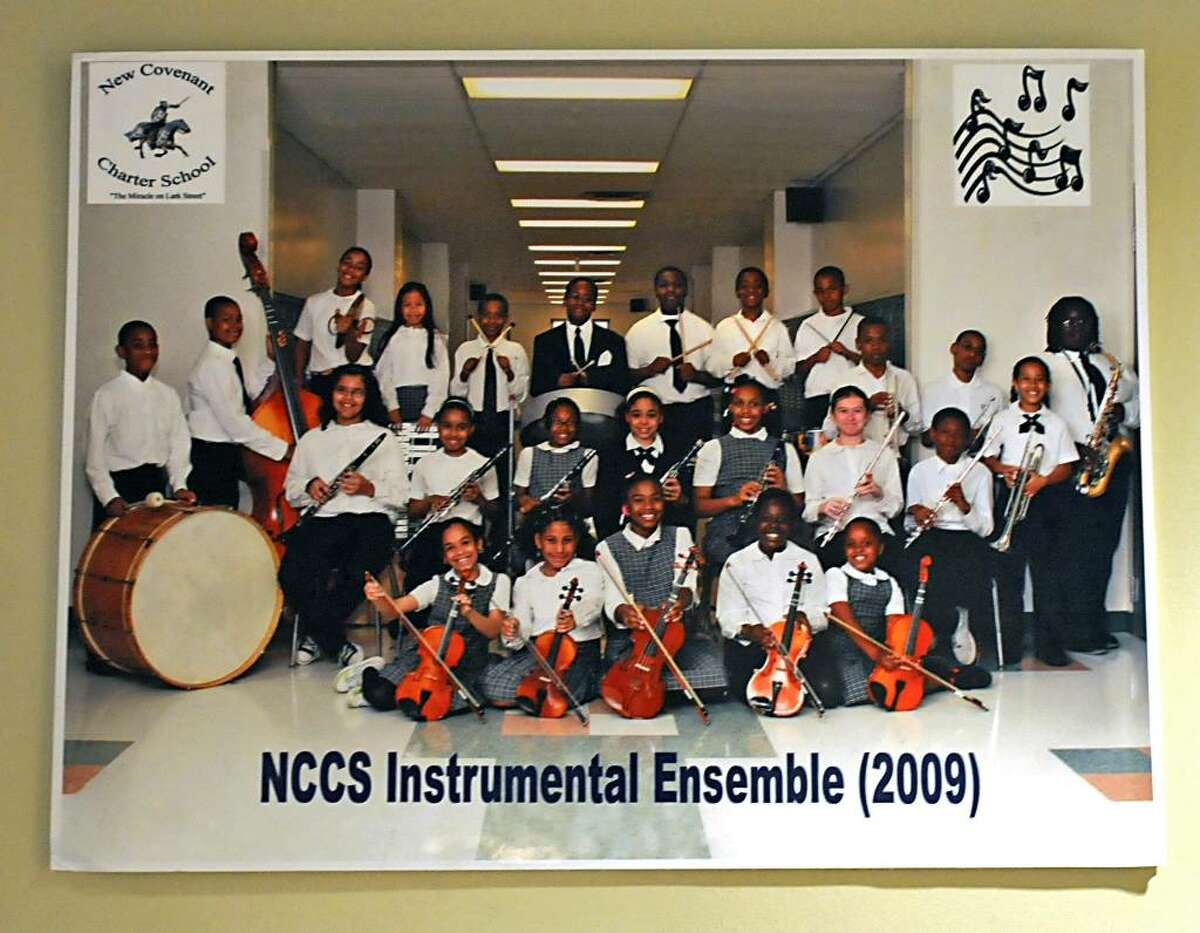 A photo of the NCCS Instrumental Ensemble from 2009 hangs in the lobby of the New Covenant Charter School in Albany, set to close this week. (Lori Van Buren/Times Union)