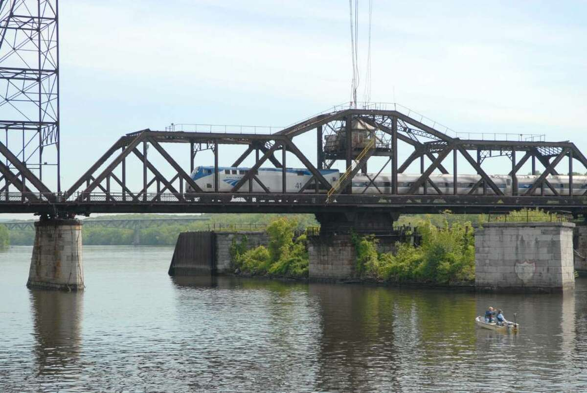 An Amtrak trains chugs across the ancient Livingston Avenue Bridge over the Hudson River near Albany, N.Y. on a Monday in May 2010. (Paul Buckowski / Times Union)
