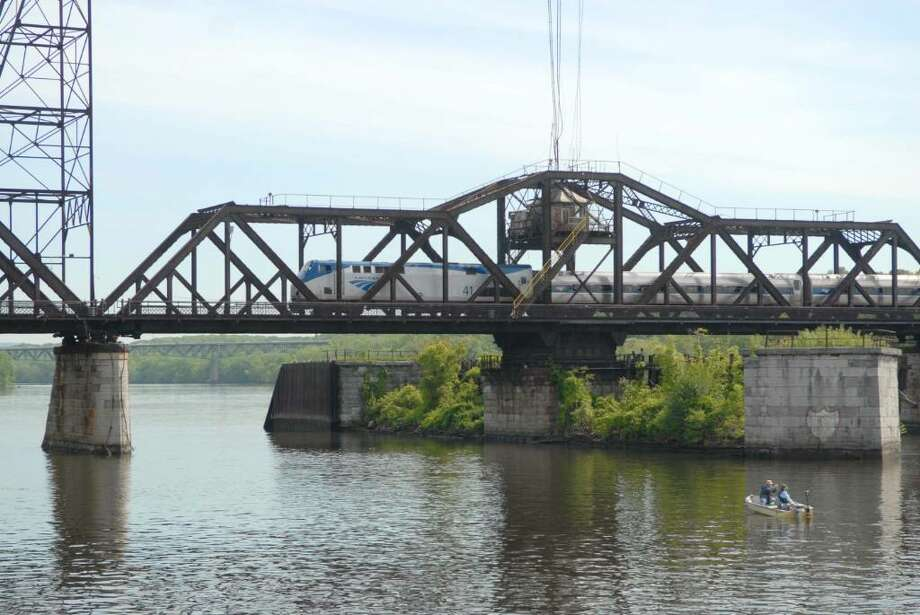 An Amtrak trains chugs across the ancient Livingston Avenue Bridge over the Hudson River near Albany, N.Y. on a Monday in May 2010.  (Paul Buckowski / Times Union) Photo: PAUL BUCKOWSKI / 00008728A