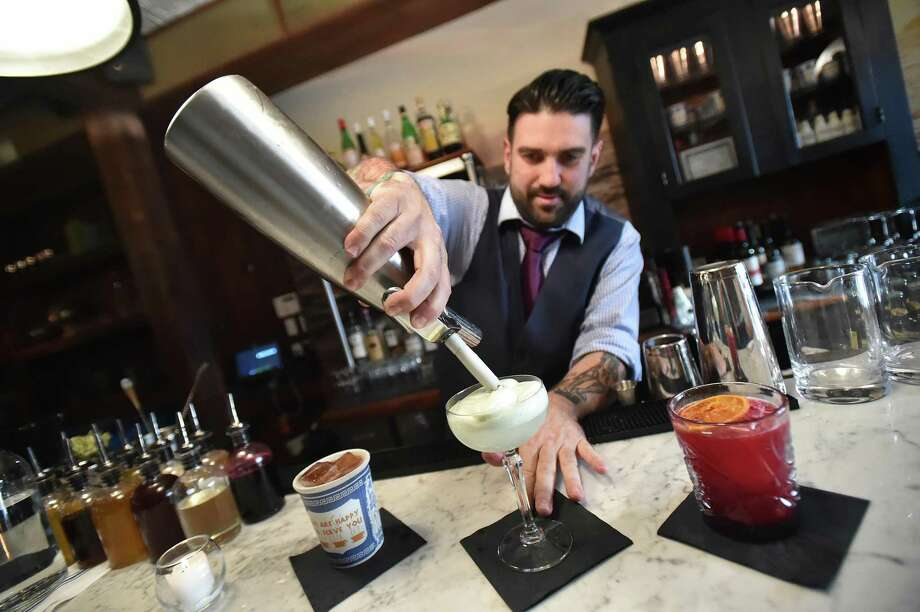 Dimitrios Zahariadis, manager at Anchor Spa in New Haven, mixes a drink. Photo: Catherine Avalone / New Haven Register File Photo / New Haven RegisterThe Middletown Press