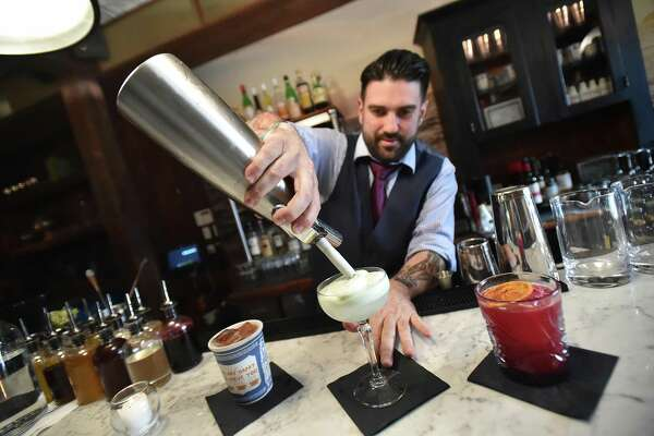 Dimitrios Zahariadis, manager at Anchor Spa, mixes a drink, at 272 College Street in downtown New Haven.