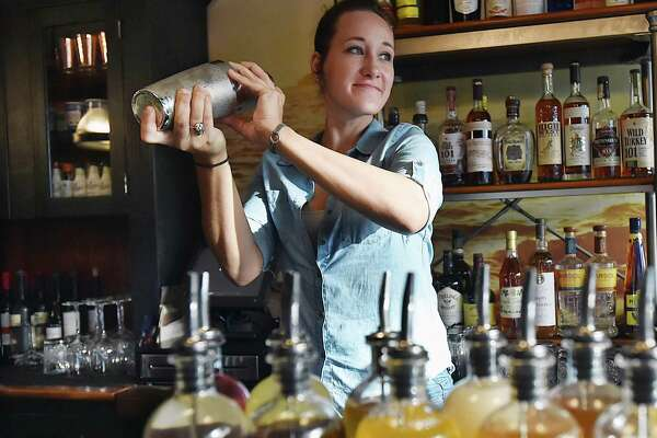 Bartender Courtney Brisson mixes a drink at Anchor Spa in New Haven.