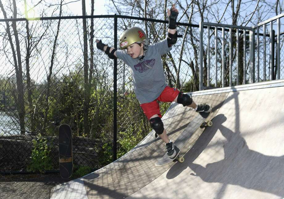 Robert Lang, 6, of Old Greenwich, drops in on a ramp during a lesson at the Greenwich Skatepark in 2016. With new concrete ramps in place, the skatepark is expected to be more popular than ever as registration for summer skate programs has opened. Photo: Tyler Sizemore / Hearst Connecticut Media / Greenwich Time