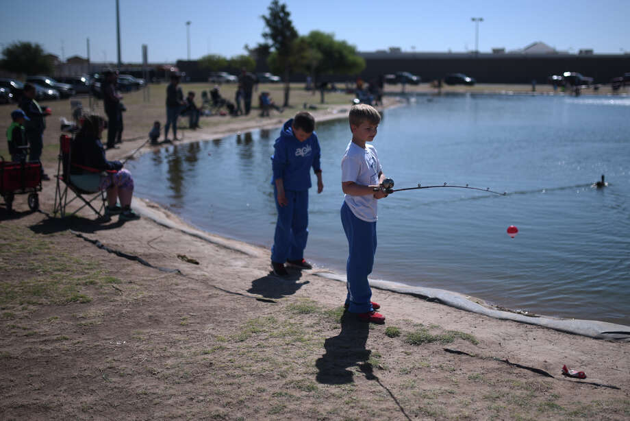Dax Cornett, age 8, prepares to cast his bait into the water, April 14, 2018, at CJ Kelly Park. Midland Parks and Texas Parks invited Midlanders for a day of free fishing, no license required. James Durbin/Reporter-Telegram Photo: James Durbin