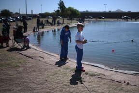 Dax Cornett, age 8, prepares to cast his bait into the water, April 14, 2018, at CJ Kelly Park. Midland Parks and Texas Parks invited Midlanders for a day of free fishing, no license required. James Durbin/Reporter-Telegram