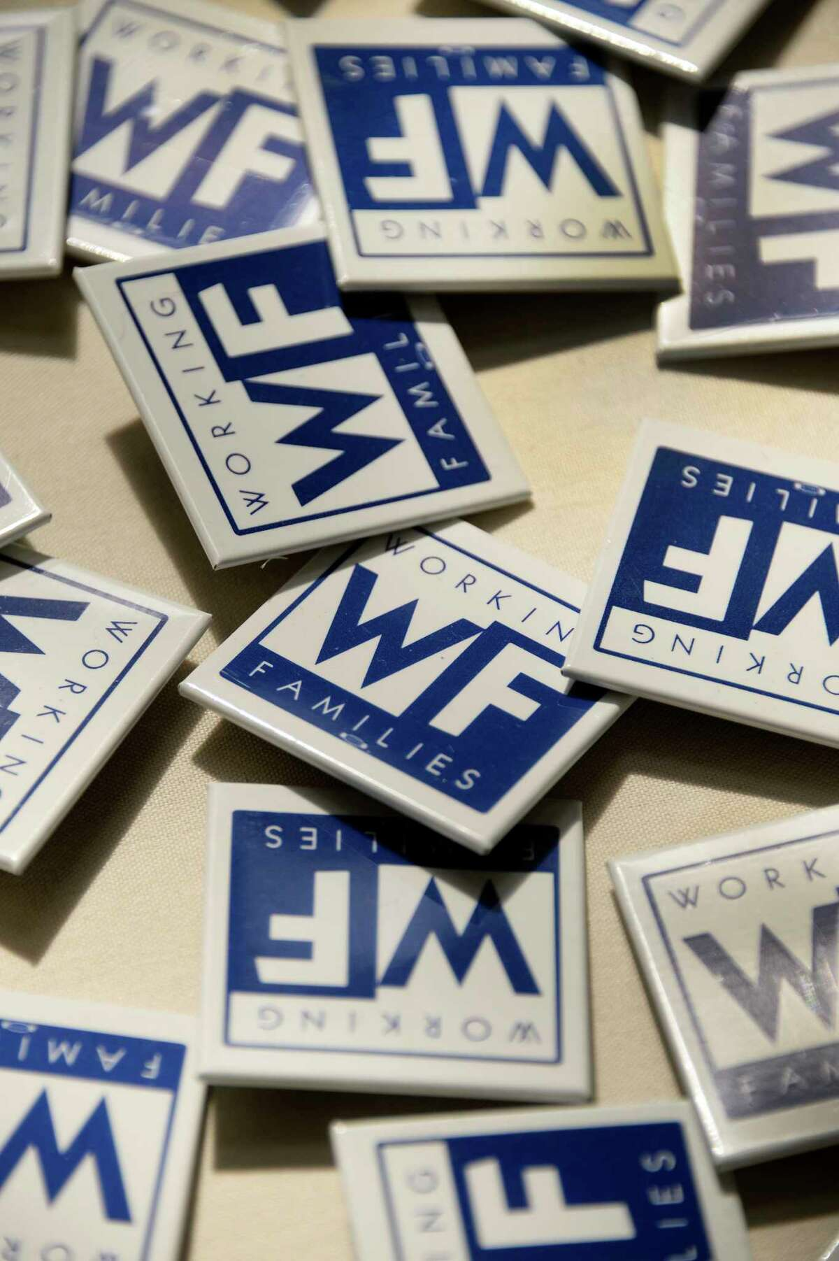 Working Families Party buttons at the sign in table at their conference Saturday April 14, 2017 in Albany, NY. (John Carl D'Annibale/Times Union)
