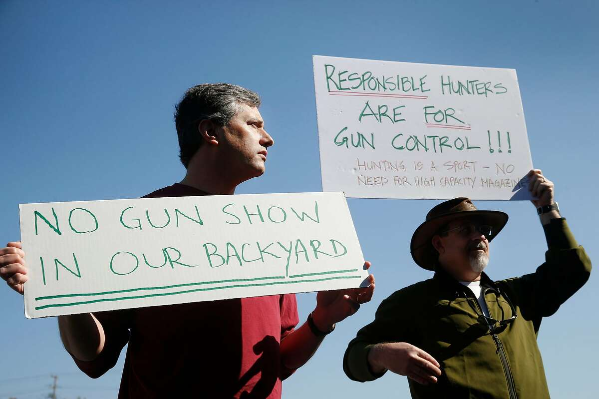 Protesters outside of the April 2018 gun show at the Cow Palace in Daly City. A new bill in the state legislature would ban gun shows at the state-owned venue.