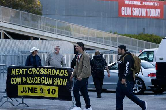 Attendees approach the ticket office for the Crossroads of the West gun show at the Cow Palace in Daly City, Calif. on Saturday, April 14, 2018.