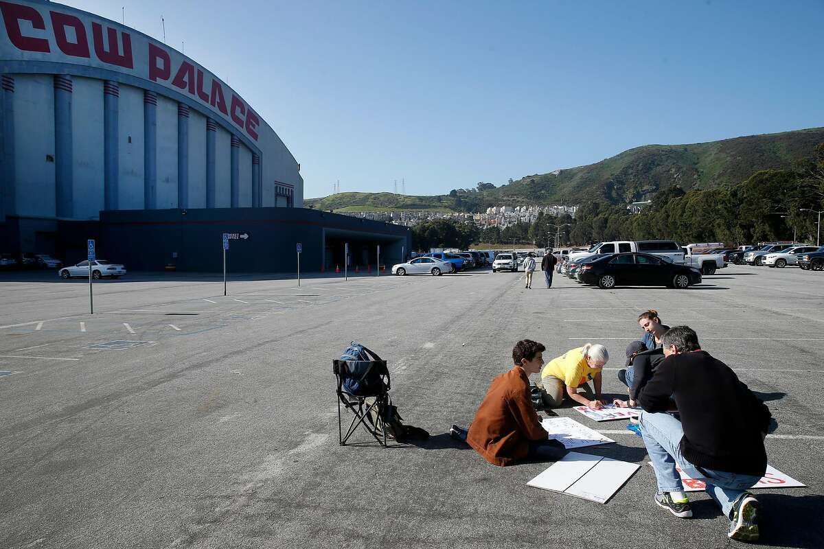 Anti-violence protesters create signs they will hold in the parking lot outside of Cow Palace where the two-day Crossroads of the West gun show is taking place in Daly City, Calif. on Saturday, April 14, 2018.